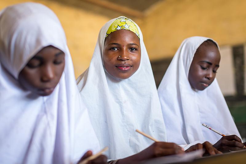 Bilky Wada, 14, sits with her classmates at the Central Miga Primary School in Jigawa State, Nigeria. Credit: GPE/Kelley Lynch