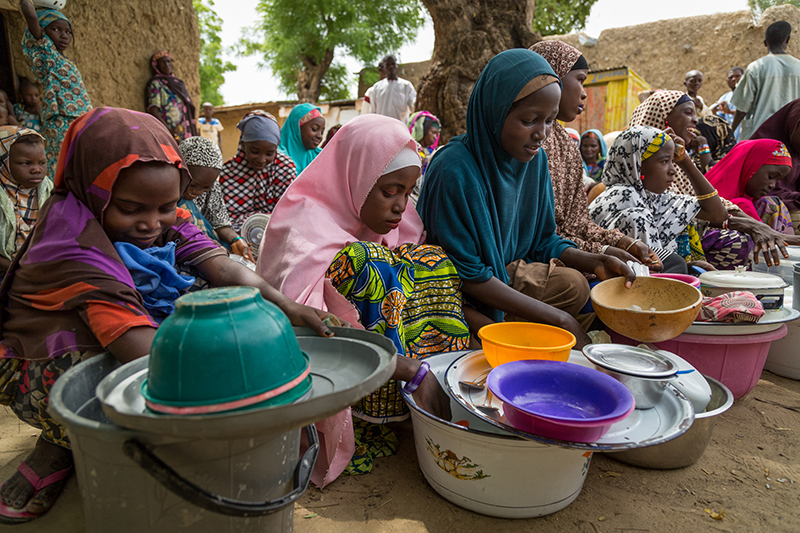 Nasiba Alhassan (pink hijab) hawking rice and beans with other girls. Jigawa State, Nigeria. Credit: GPE/Kelley Lynch