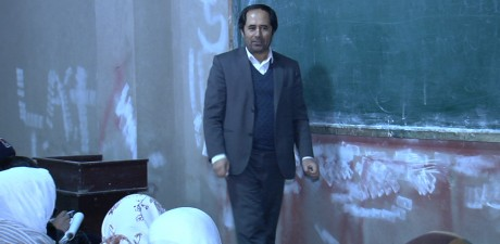 Aziz Royesh standing in front of a classroom
