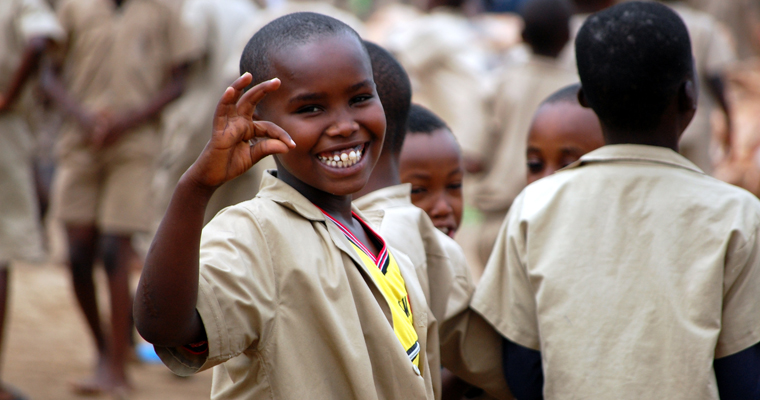 A school child smiles in the courtyard of Kanyosha Primary School in Burundi. Credit: UNICEF Burundi/Nijimbere