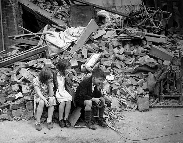 Children in the East End of London in the rubble of what had been their home (1940)