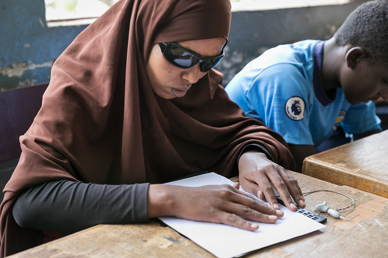 A blind student at Sebeta School for the Blind checks her answers after taking a geography exam; Sebeta, Oromia, Ethiopia. June 2019. Credit: GPE/Kelley Lynch