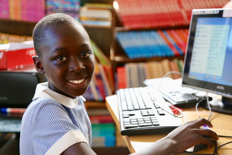 4th grade student Thandiwe, 10, using a computer at school, Zimbabwe. Credit: GPE/ Carine Durand