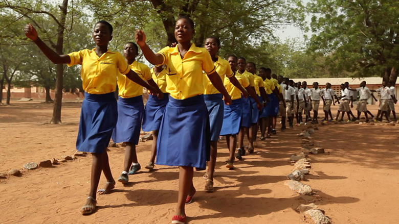 School girls marching to their classrooms after morning assembly. Credit: GPE/ Stephan Bachenheimer