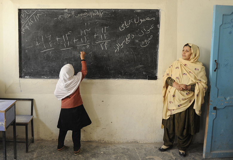 A girl at the blackboard at Ayno Meena Number Two school in the city of Kandahar, Afghanistan. Credit: GPE/Jawad Jalali
