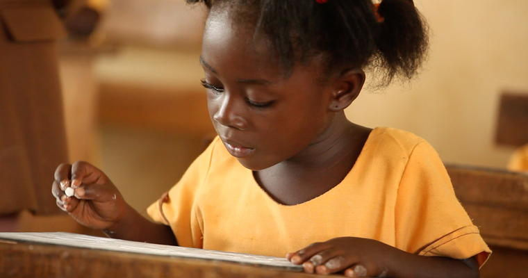 A school girl writes in Ghana. Credit: GPE/Stephan Bachenheimer