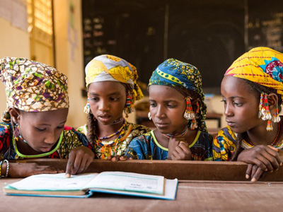 Fulani girls share a textbook. Despite being in class three, these girls cannot read more than a few words in the textbook. The teacher prompts them, word by word. Ecole Patti, Makalondi, Tilaberri Region, Niger. CREDIT: GPE/Kelley Lynch