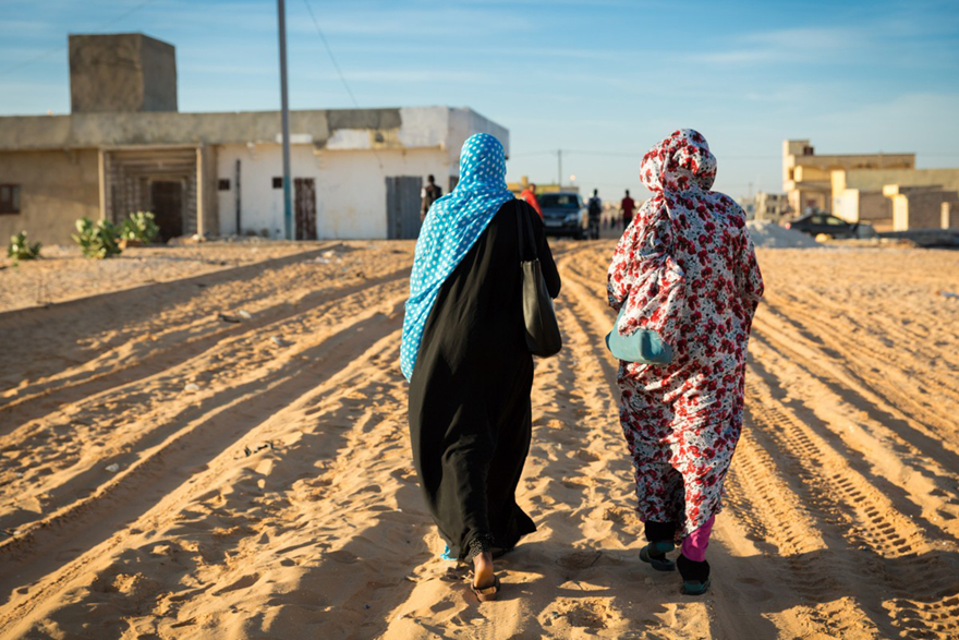 Aichetou and her friend Meia on the way to school in Tarhil, Nouakchott, Mauritania. Credit: GPE/Kelley Lynch