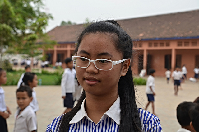 Sier is 14 years old and in grade 9. She now wears glasses and sees well in class, thanks to a vision screening pilot project that took place in Siem Reap in 2012. Credit: GPE/Aya Kibesaki