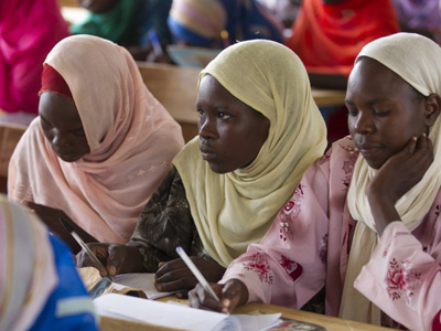 Three girls listen attentively in class, October 2012. Chad has been working with GPE to strengthen its education system since 2012. However, the influx of refugees fleeing Boko Haram and violence in North-Western Nigeria has put additional strain on the Ministry, which is committed to educating all children in the country. CREDIT: Educate a Child