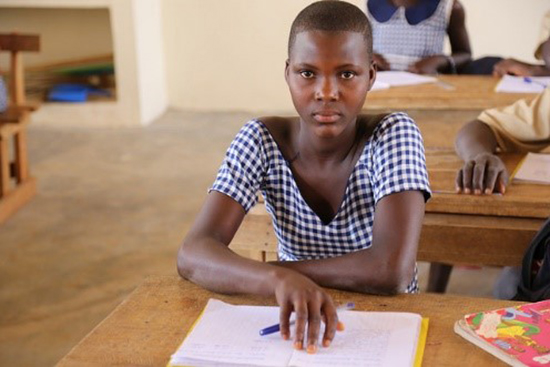 Juliana, the daughter of two cocoa farmers in Mamakoffikro, Cote d'Ivoire, is the first girl in her family to go to school.