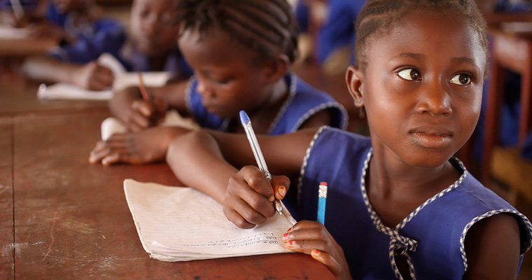 A girl writes in a school in Sierra Leone. Credit: GPE/Stephan Bachenheimer