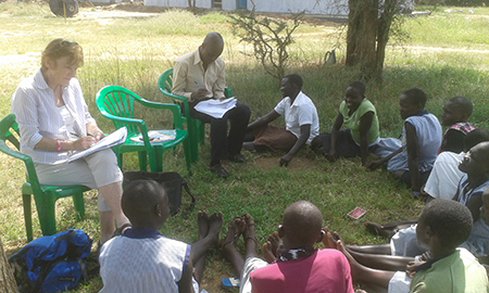 Pauline Faughnan gathering data on what keeps girls out of school in Moroto and Kotido districts of Uganda. Credit: VSO