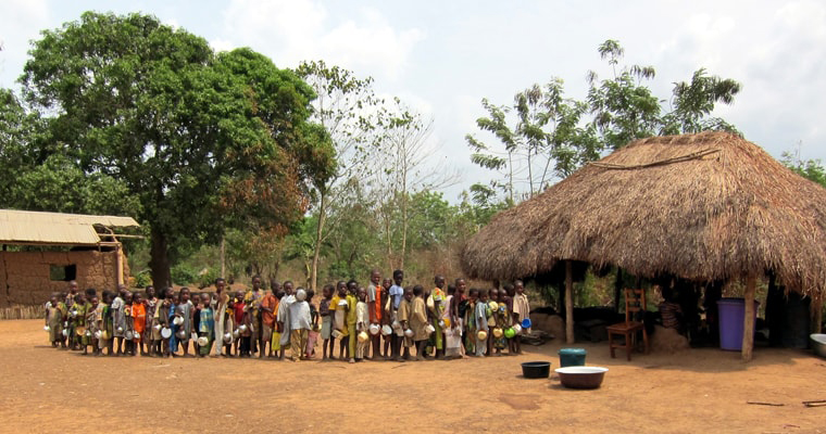 Kids in line for food at the canteen of a school in Benin. Credit: Cordelia Persen