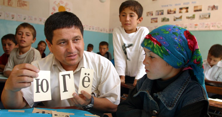A teacher and a student in a classroom in Tajikistan. Credit: UNICEF