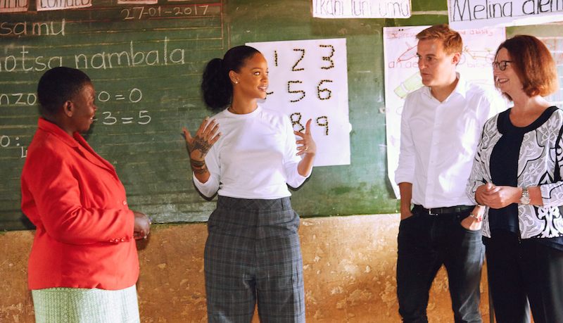 Rihanna, Hugh Evans, and Julia Gillard in a first grade class at Mpingu primary school in Malawi. Credit: Evan Rogers
