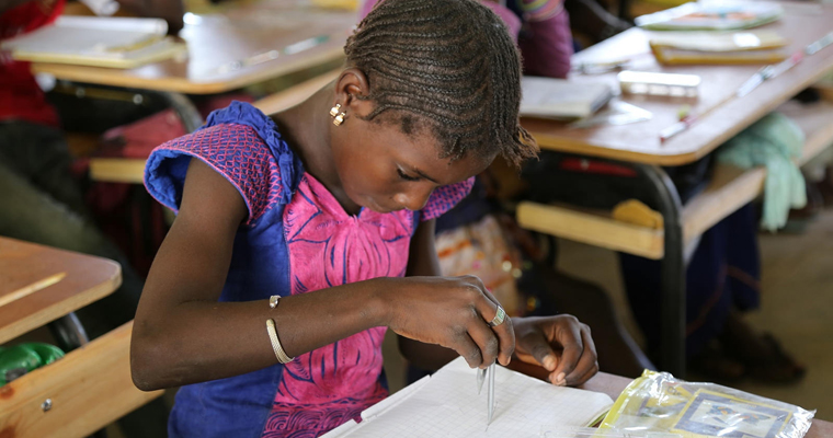 Student using a compass in class at Maka Dieng Primary School in Tivaouane, Senegal. Credit: GPE/Chantal Rigaud