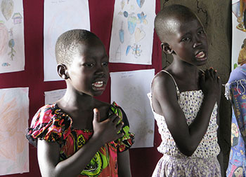 Two girls sing the national anthem of South Sudan at the Gudele West Basic School near Juba. South Sudan.