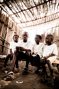 Grade 1 students sitting in a classroom in Kimpoko village, DRC