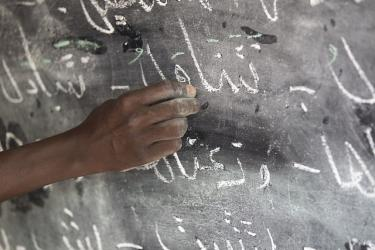 Writing on the blackboard. Chad. Credit: Educate a Child