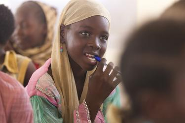 A young girl listens during class in a school in Chad. Credit: Educate a Child