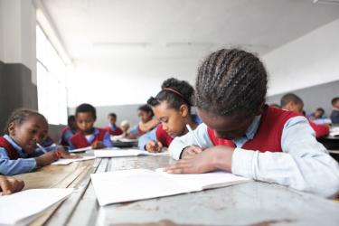 School girls listen and write during class. Hidassie School. Addis Ababa, Ethiopia. Credit: GPE/Midastouch