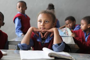 A student listens with attention during instruction in Ethiopia. Credit: GPE/Midastouch