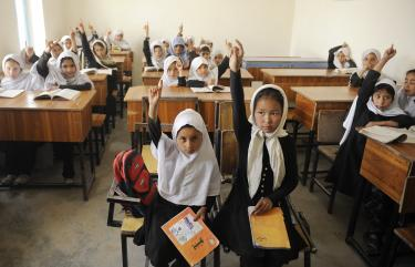 Students raise their hands to answer the teacher's question. Ayno Meena Number Two school in the city of Kandahar, Afghanistan which was built in late 2008 with support from the World Bank. Credit: GPE/Jawad Jalali
