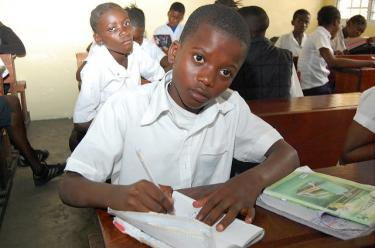 A student learns math in a primary classroom in Kinshasa. Credit: GPE/Guy Nzazi