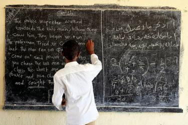 A student writes on the blackboard in a school in Somalia. Credit: UNICEF/Hana Yoshimoto