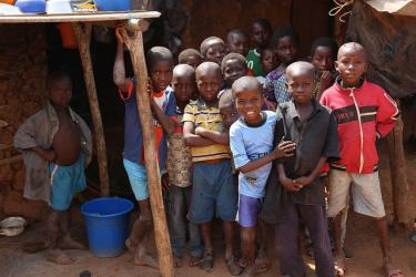 Young children from Ouragahio posing in front of one of the houses of the village, Côte d'Ivoire. Credit: GPE/ Carine Durand