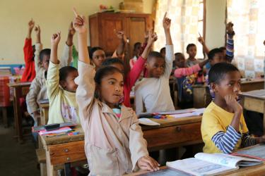 A girl raises her hand during class. Madagascar. Credit: GPE/Carine Durand