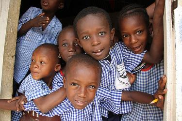 Gambian school children. Credit: John Savage