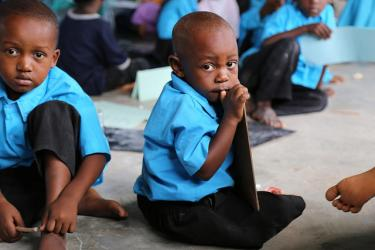 This 3-year old boy likely followed an older brother or sister into class, which should start at 4. Mnyimbi TuTu center in the North province, Zanzibar. Credit: GPE/Chantal Rigaud