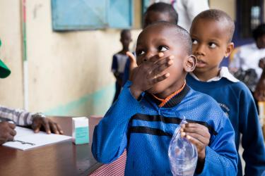 Students from Atu government school in Calabar, Nigeria, receive medicines for neglected tropical diseases during mass drug administration. Credit: RTI International/Ruth McDowall