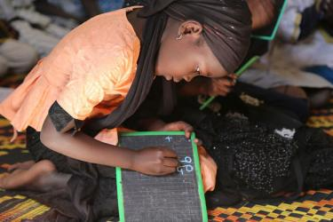 A girl writes on a slate in Daara Serigne Mansour Sy. Tivaouane, Senegal. Credit: GPE/Chantal Rigaud