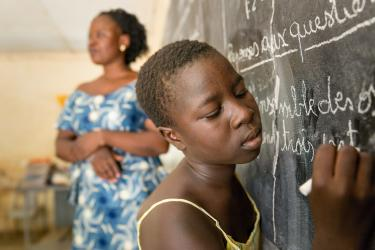 A student writes at the blackboard in a school in Burkina Faso. Credit: GPE/Kelley Lynch
