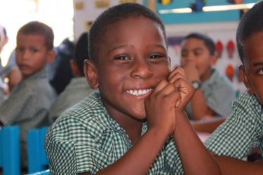 A young boy smiles at the camera at the Precious Gems Nursery. Guyana. Credit: GPE/Carolina Valenzuela