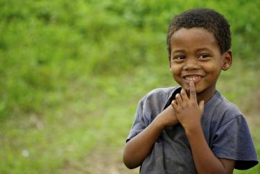 A child poses for the camera in Sao Tome. Credit: Helena Van Eykeren