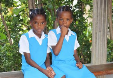 Two school girls look at the camera. St Vincent & the Grenadines. Credit: Martin Wippel