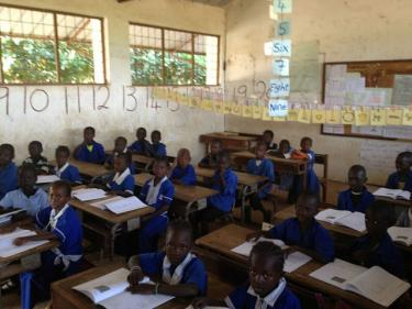 Girls and boys sit in the classroom at their desks ready to learn. The Gambia, March 2013 Credit: GPE