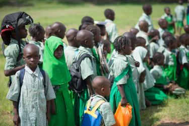 Primary school students line up before class at Kuje primary school in Abuja, Nigeria. Credit: A World At School/Nick Cavanagh