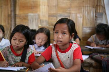 Children during a class at the Ban Tractor refugee camp on the Thai/Myanmar border. Credit: Wikimedia Commons/Gary Moore