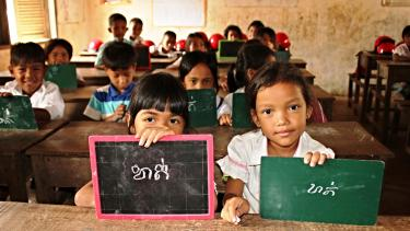 Young girls hold up their chalk boards. Banteay Dek Primary School, Cambodia March 2015. Credit: GPE/Livia Barton