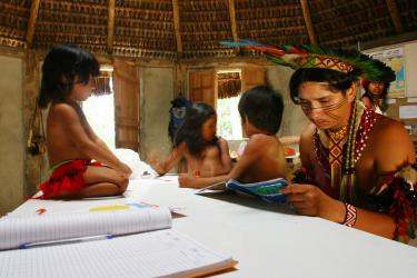 Jaqueira Village. Porto Seguro, Bahia, Brazil (2008). An indigenous teacher of the Pataxó ethnic group teaches students in their native language Patxôhã. Credit: CLADE