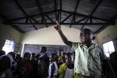 A boy raises his hand in class, Burundi. Credit: UNICEF Burundi/Colfs