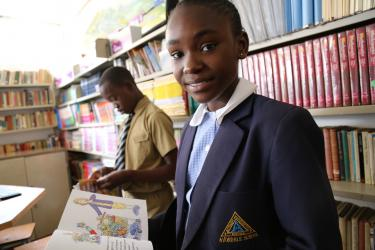 6th grade student Ruramai reads a poems book at school, Avondale Primary School, Zimbabwe. Credit: GPE/Carine Durand