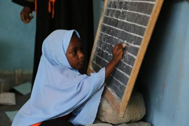 A little girl writes numbers on the blackboard at Mnyimbi TuTu Center in Zanzibar, Tanzania. Credit: GPE/Chantal Rigaud
