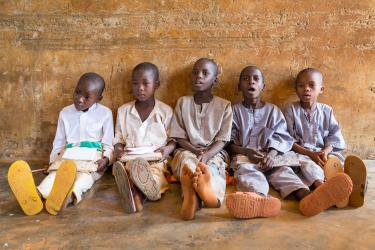 Children sit on the ground during lessons in Nigeria. Credit: GPE/Kelley Lynch