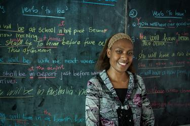 Grade 11 teacher Annette teaches English to her students at Norsup Secondary School. Credit: Connor Ashleigh for AusAID